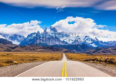 The road through the desert. The highway crosses Patagonia and conducts to snow-covered top of Mount Fitzroy
