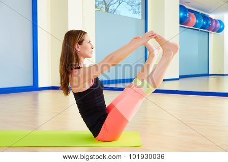 Pilates woman open leg rocker exercise workout at gym indoor poster
