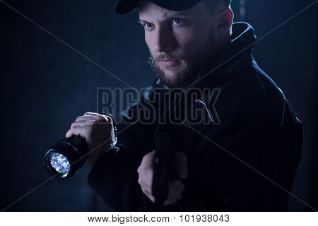 Policeman Using Flashlight
