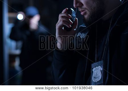 Officer Using Walkie Talkie