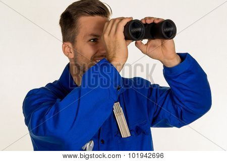 a worker in a business enterprise (craftsmen) with binoculars looking for jobs or jobs