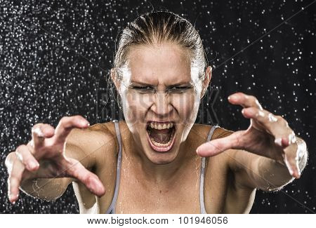 Angry Female Fighter Reaching Hands Towards Camera