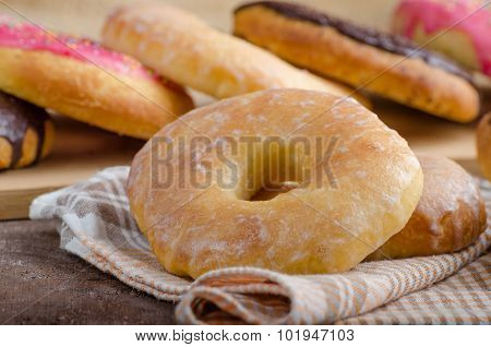 Homemade donuts big one for bigger hunger chocolate pinky and suger american cap morning place for advertising poster