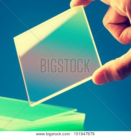 Bulletproof super hard glass based on structured nanocrystals. Colored image poster