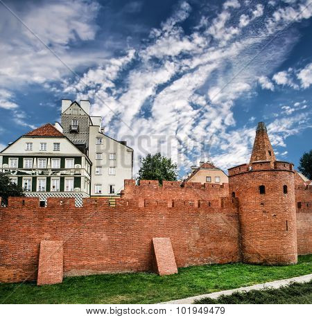 fortified medieval outpost Barbakan against sky in Warsaw in Poland