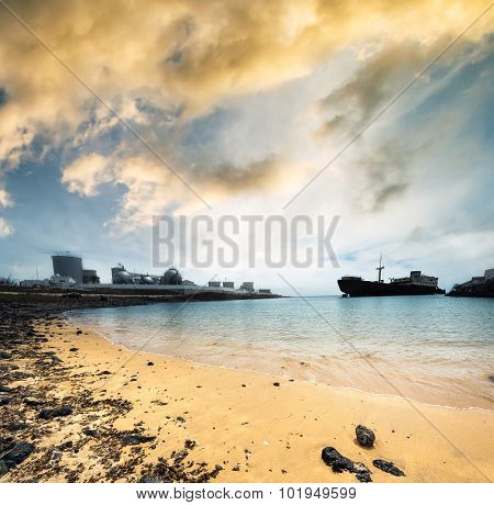 old broken ship agrounded near Lanzarote seashore at sunset, Canary Islands, Spain