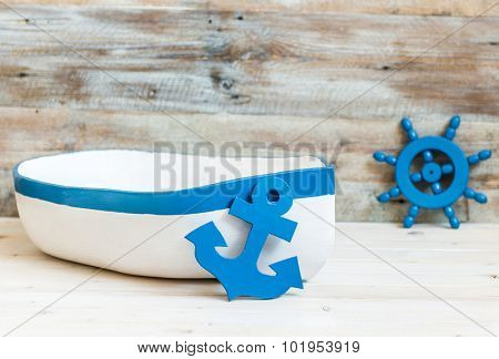 little toy boat with anchor and helm for children photo shoots