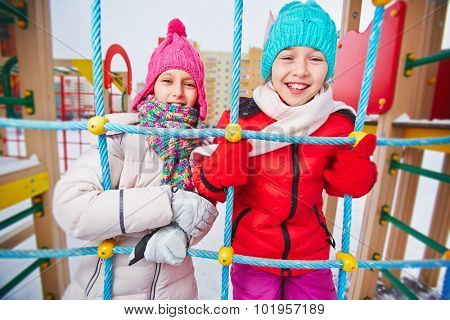 Two girls in winterwear having fun outdoors