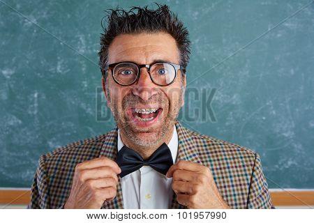 Nerd silly retro teacher man with braces funny expression bow tie portrait