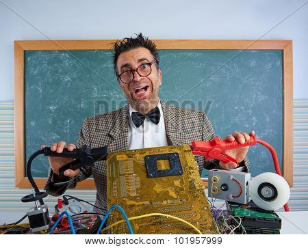 Nerd electronics technician retro teacher silly expression with big battery clamps in pcb