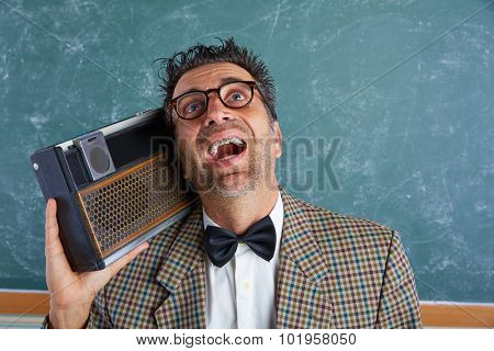 Nerd silly retro teacher man with braces and vintage radio and crazy expression