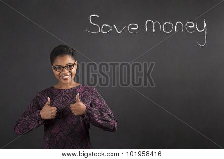 African Woman With Thumbs Up Hand Signal To Saving Money On Blackboard Background