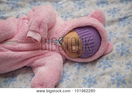 Newborn baby in bear costume