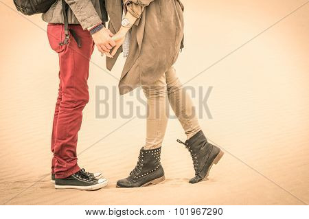 Concept Of Love In Autumn - Couple Of Young Lovers Kissing Outdoors With Closeup On Legs And Shoes