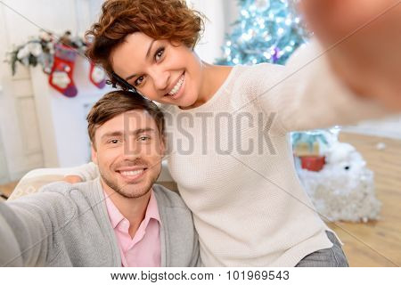 Loving couple sitting in the arm chair