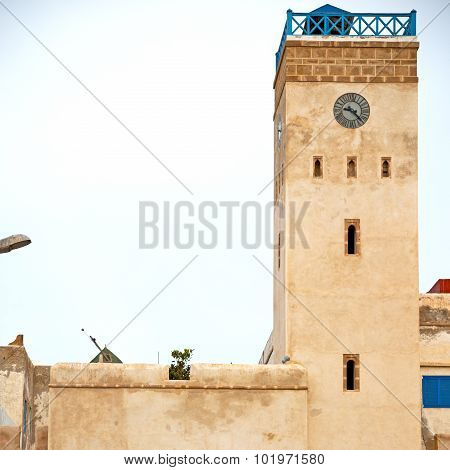 Old Brick Tower In Morocco Africa Village And The Sky