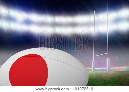 Japanese flag rugby ball against rugby pitch