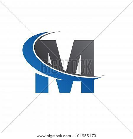 M blue swoosh logo
