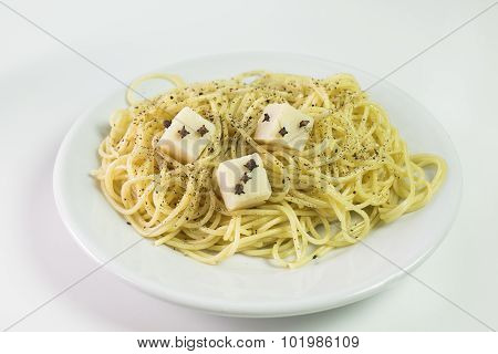 spaghetti with cheese cubes