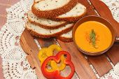 Salmon and carrot cream served with whole wheat bread on wooden borad poster