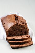 Loaf of chocolate cake wrapped with muslin cloth poster