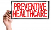 Hand with marker writing the word Preventive Healthcare poster