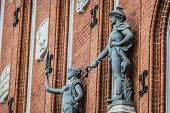 Sculptures on the facade of the House of Blackheads in Riga Latvia. poster