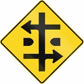 An Canadian warning traffic sign - Intersection at dual carriageway. This sign is used in Quebec. poster