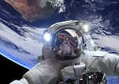 Astronaut in outer space against the backdrop of the planet earth. Elements of this image furnished by NASA. poster