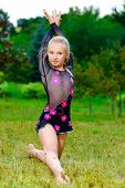 Image of flexible little girl doing gymnastics split poster