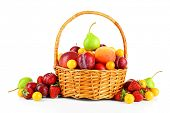 Heap of fresh fruits and berries in basket isolated on white poster