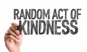 Hand with marker writing the word Random Act of Kindness poster