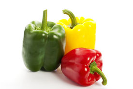 Three colourful peppers