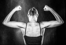 Gym Fit Woman Showing her Arm and Back Muscles
