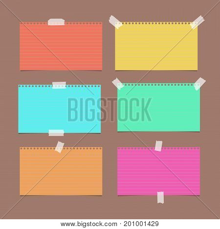 Colorful ruled, striped note, copybook, notebook paper sheet on brown background