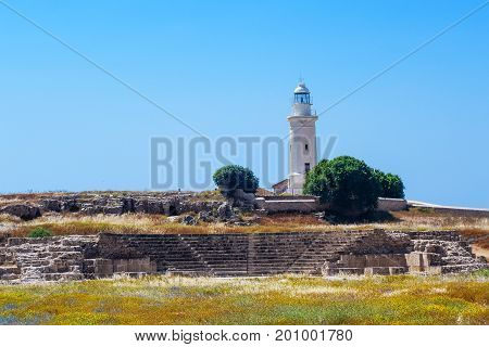 Antient greek amphitheater and lighthouse in Archaeological park at Kato Paphos, Cyprus