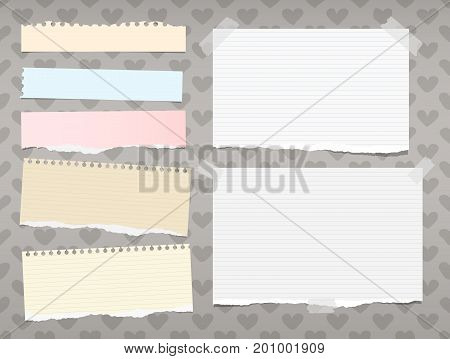 White and colorful ripped ruled, striped note, copybook, notebook paper stuck on background created of hearts shape