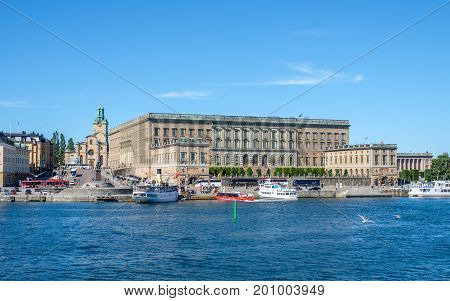 STOCKHOLM, SWEDEN - JULY 6, 2017: The Royal Palace viewed from Skeppsholmen bridge in Stockholm. The palace which was completed in 1754 has 1430 rooms.