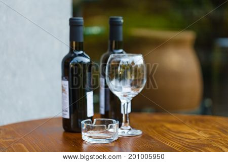 Glass of wine at tasting area with bottle