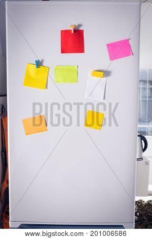 Sticky notes stuck on refrigerator