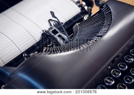 Close up of typewriter with paper