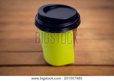 Close up of adhesive note stuck on disposable cup at table