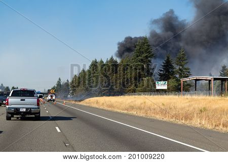 OLYMPIA, WASHINGTON, USA - AUGUST 22, 2017: Brush fire along I-5 south of Olympia causes right northbound lane closure further aggrevating  traffic congestion.