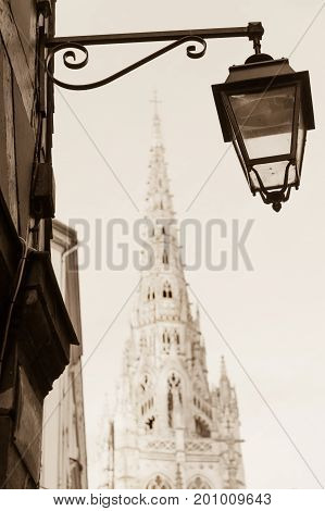 Street lamp and Roen cathedral in historic part of Rouen, France