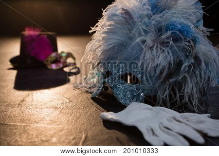 Masquerade masks, gloves and hat on stage