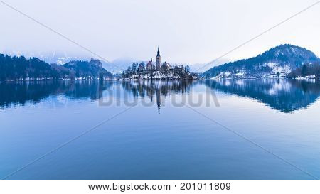 Perfect symetry of a lake and church on a small island, Bled, slovenian alps, Slovenia