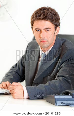 Angry modern business man banging fist on table