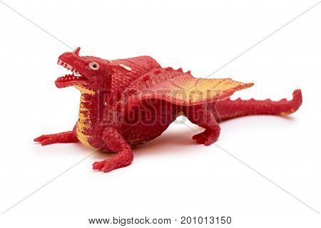 plastic dragon toy isolated on white background.