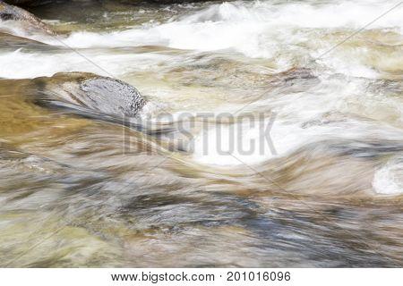Blur Of Flowing Waters