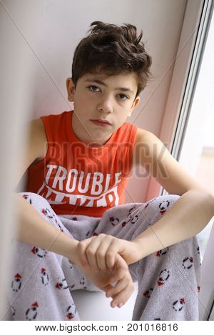 Teen Boy In Trouble Maker Tshirt And Pahama Pants C